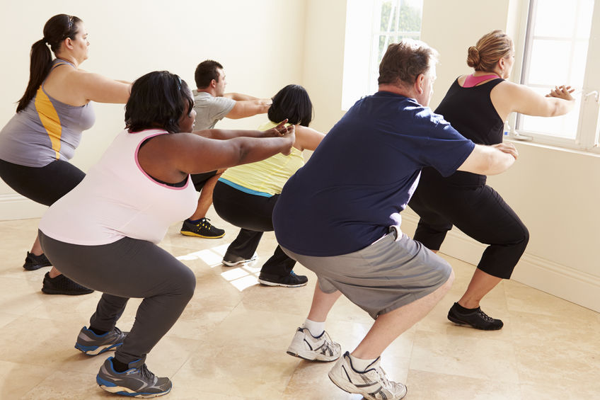 33545679 - fitness instructor in exercise class for overweight people
