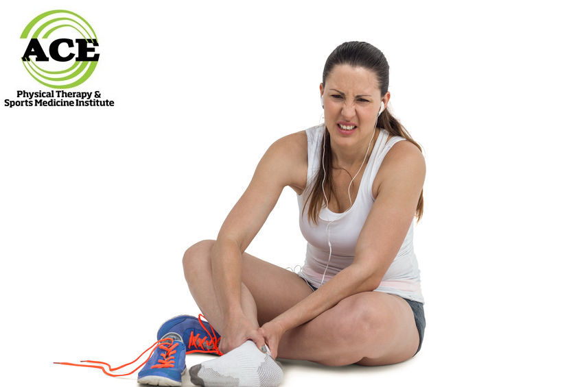 58470059 - athlete woman with foot pain on white background