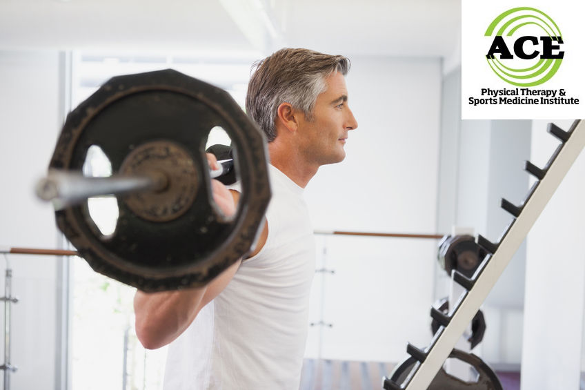 33931343 - fit man lifting heavy barbell at the gym