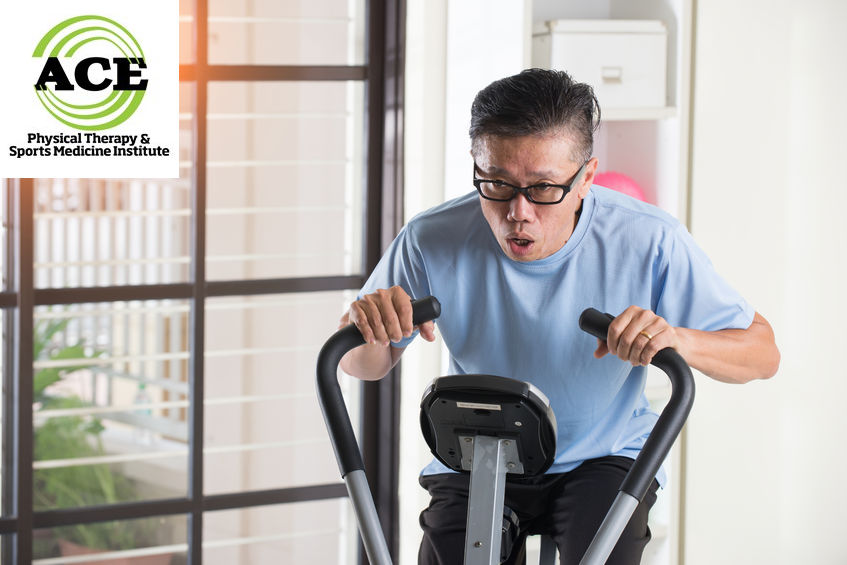 66974464 - matured asian male on exercise bike