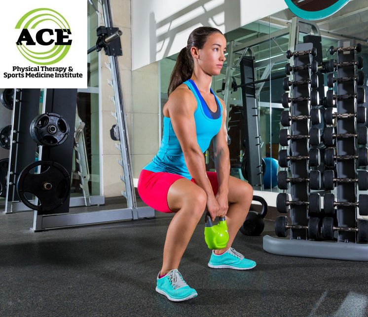 34242406 - goblet kettlebell squat woman workout exercise at gym