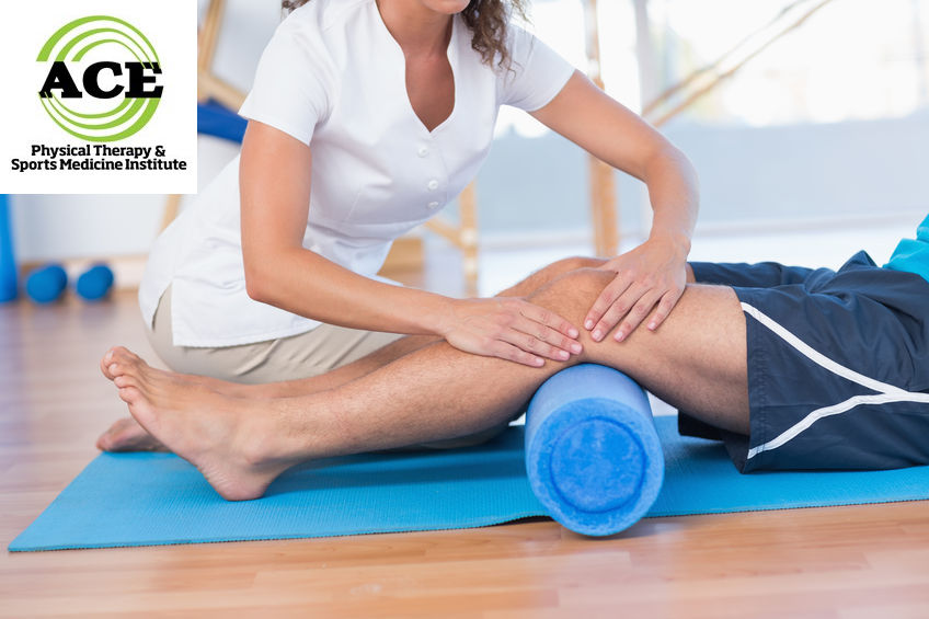 38333145 - trainer working with man on exercise mat in fitness studio