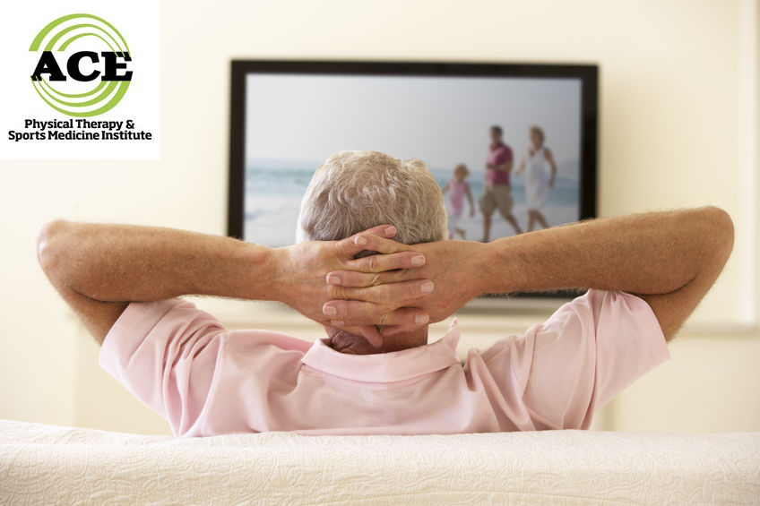 42397721 - senior man watching widescreen tv at home