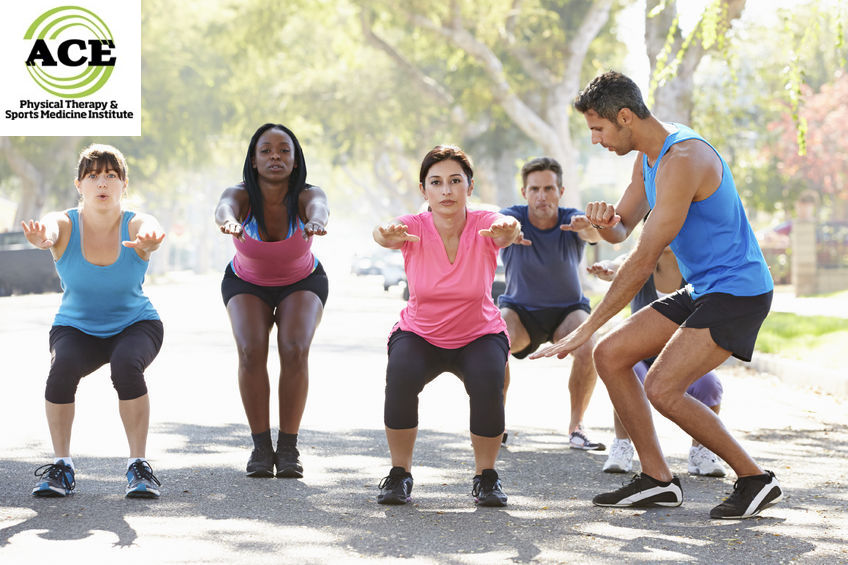 24490028 - group of people exercising street with personal trainer