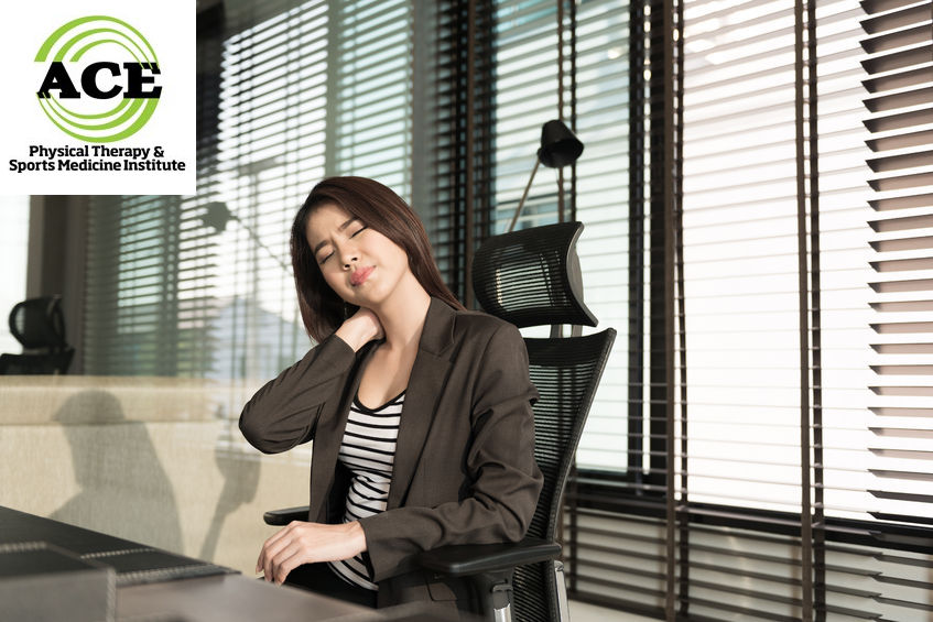 39343281 - young businesswoman with neck pain sitting at office desk
