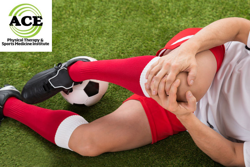 39899730 - close-up of male soccer player suffering from knee injury on field
